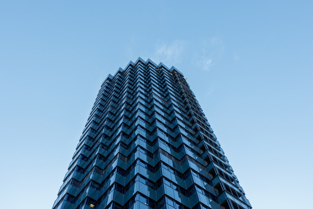 blue building worms-eye view