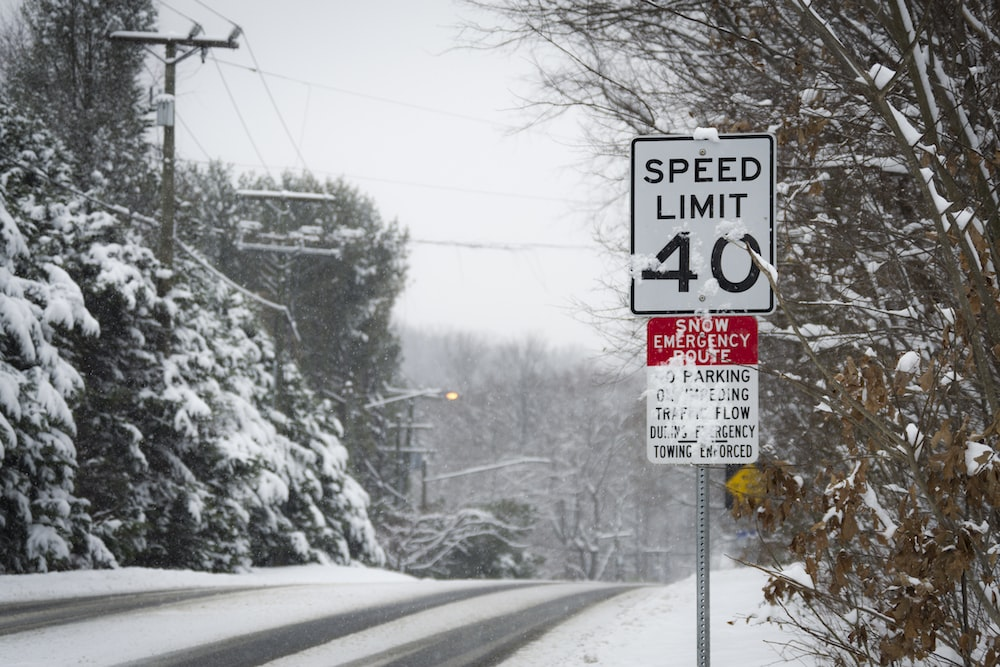 white and black speed limit signage
