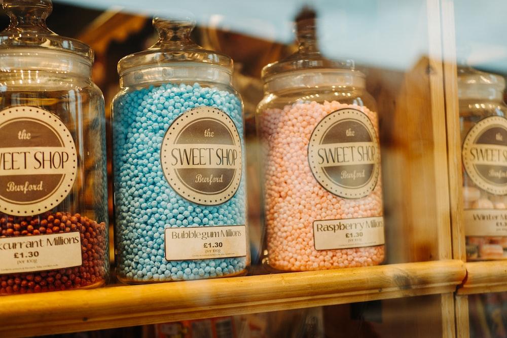 Sweet Shop jars on wooden shelf