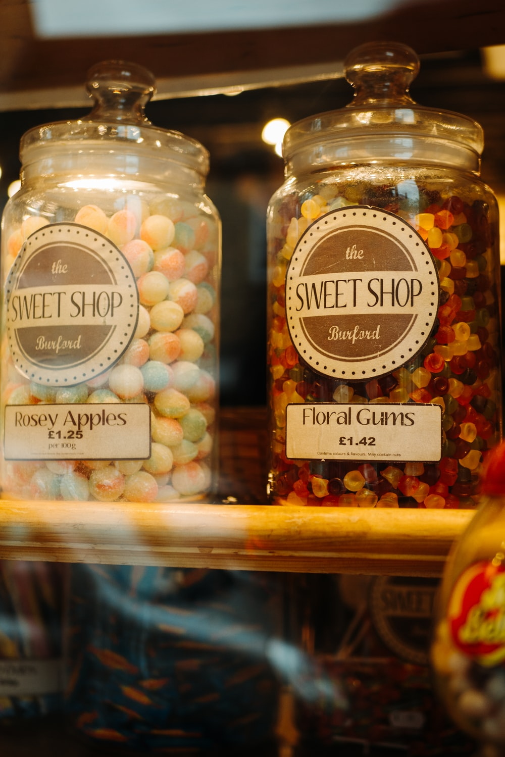 two clear glass canisters with candies