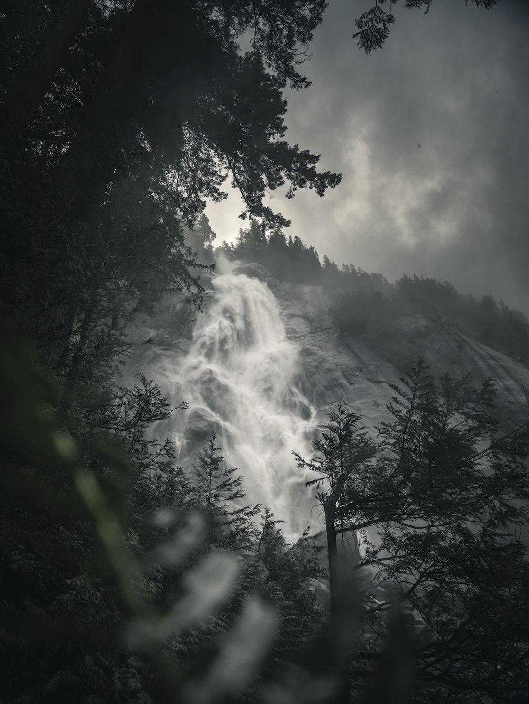 grayscale photo of waterfalls