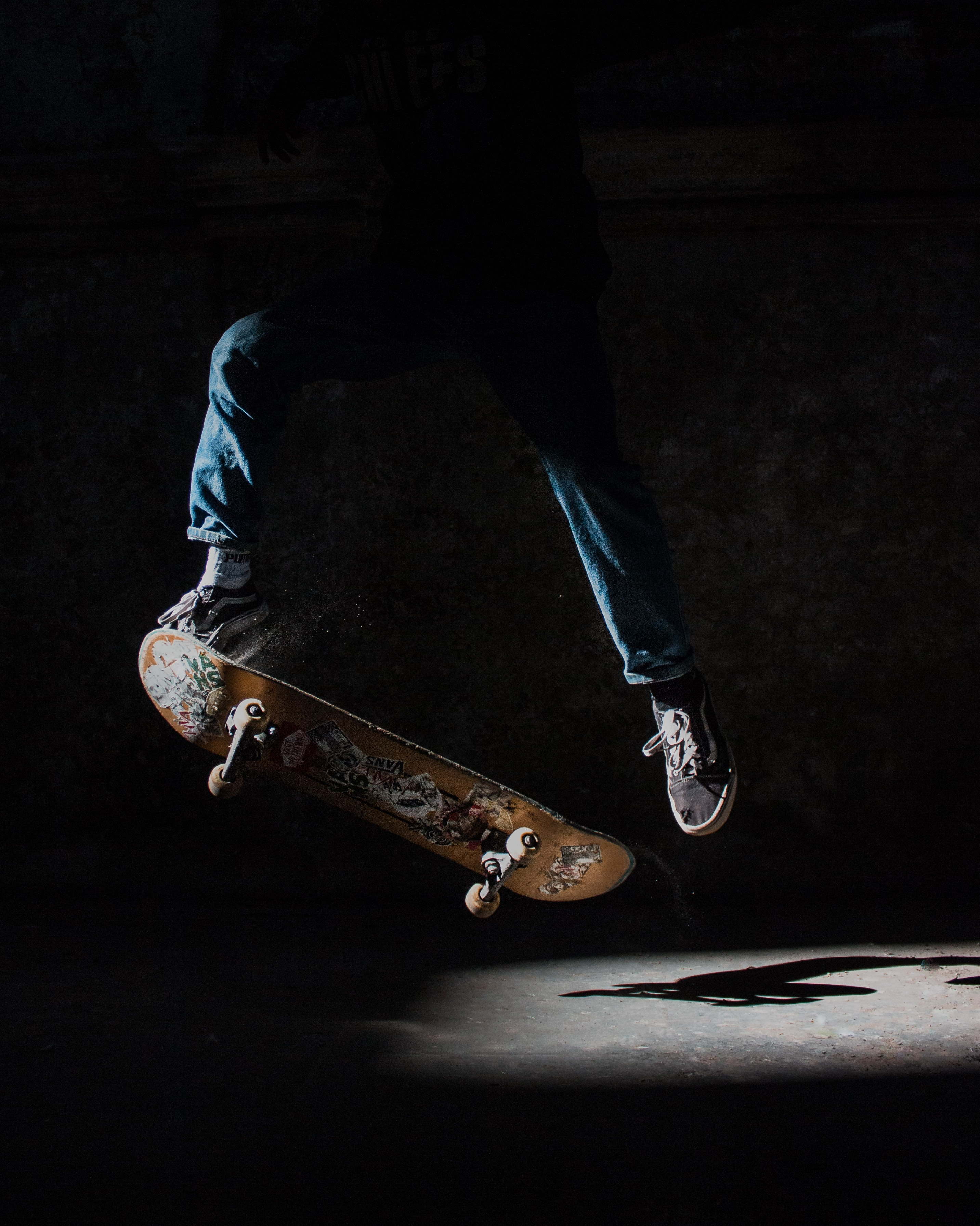 person about to stunt using brown skateboard