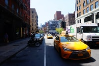yellow Toyota Camry Taxi on road
