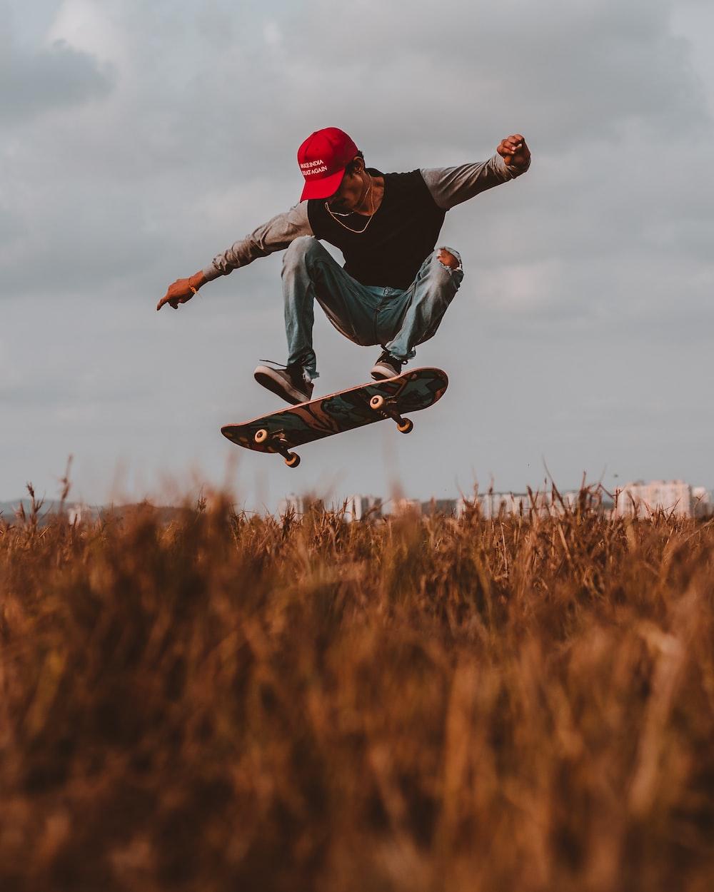 man performing skateboard trick during daytime