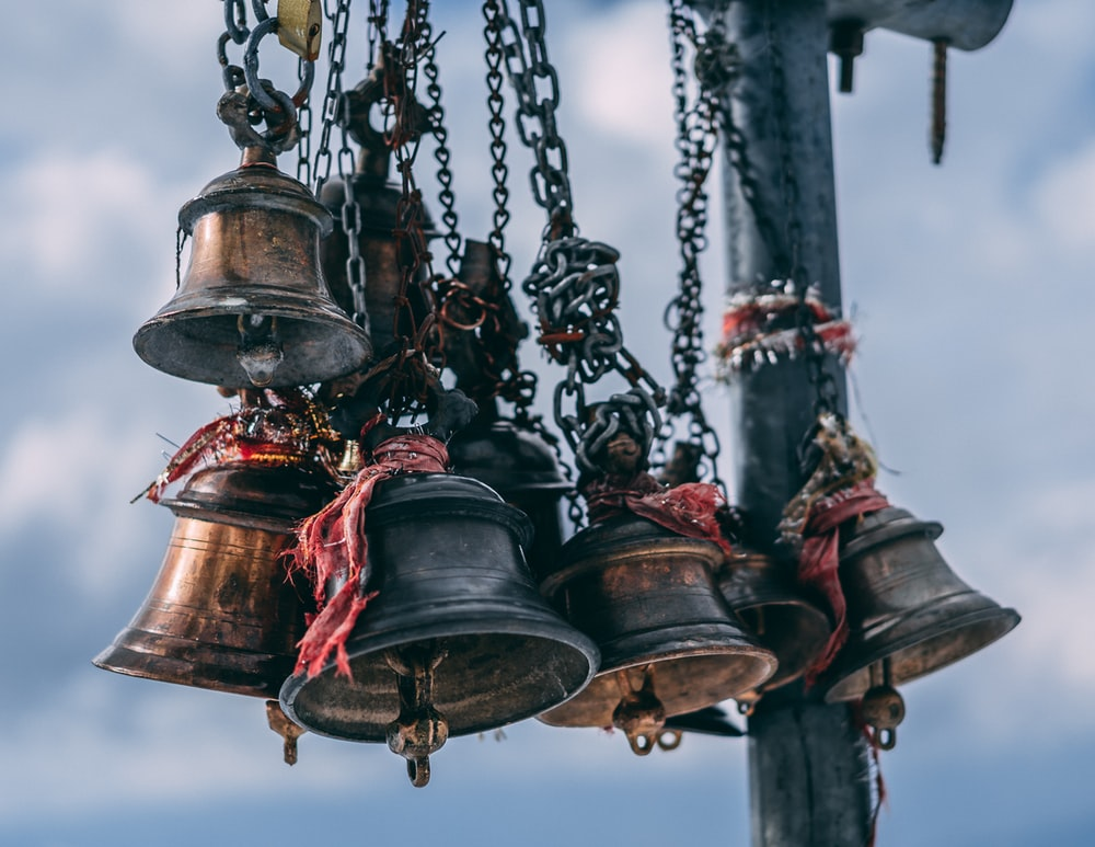 bell hanging on rod