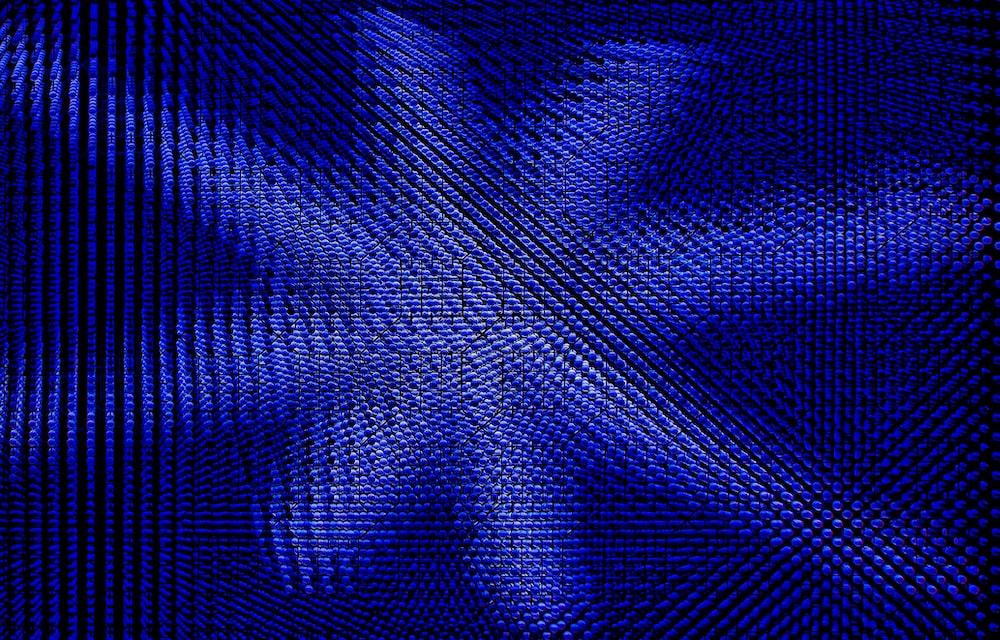 blue and black plaid textile