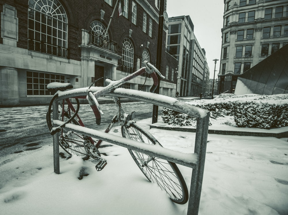 road bike parked on street with snow