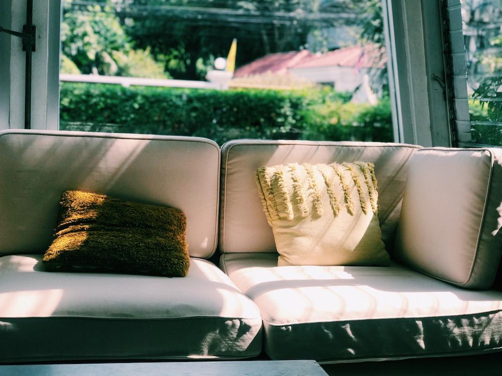 gray fabric sofa with throw pillows