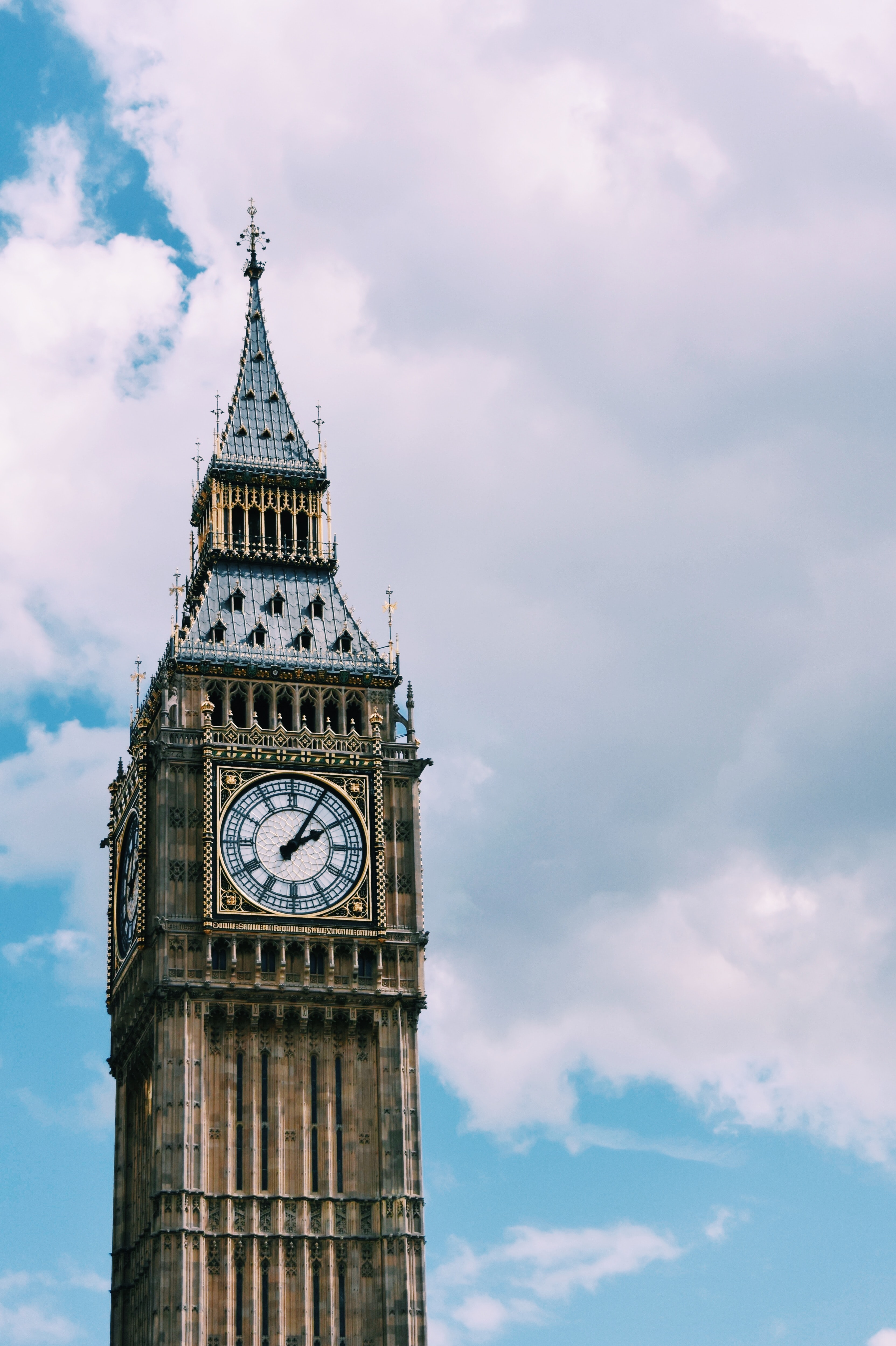 Big Ben Tower, London under white and blue sky