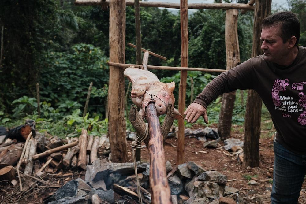 man beside roasted meat