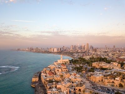 aerial view photography of city beside body of water israel zoom background