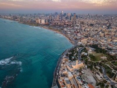 aerial photo of city by the sea israel zoom background