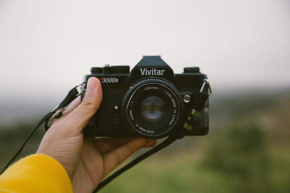 black Vivitar DSLR camera