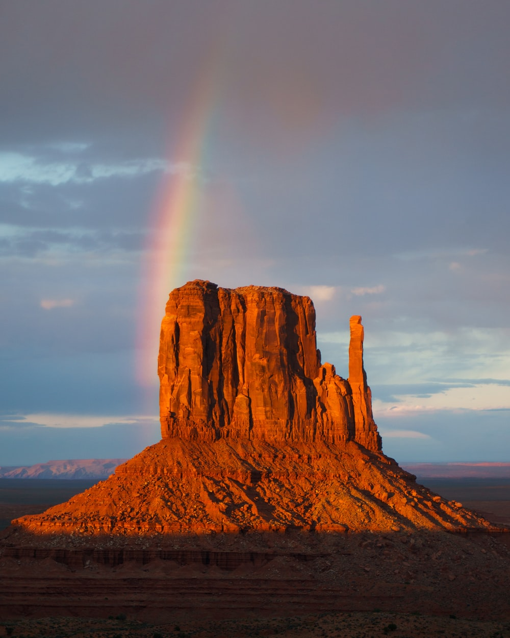 Rainbow over rock formation during daytime