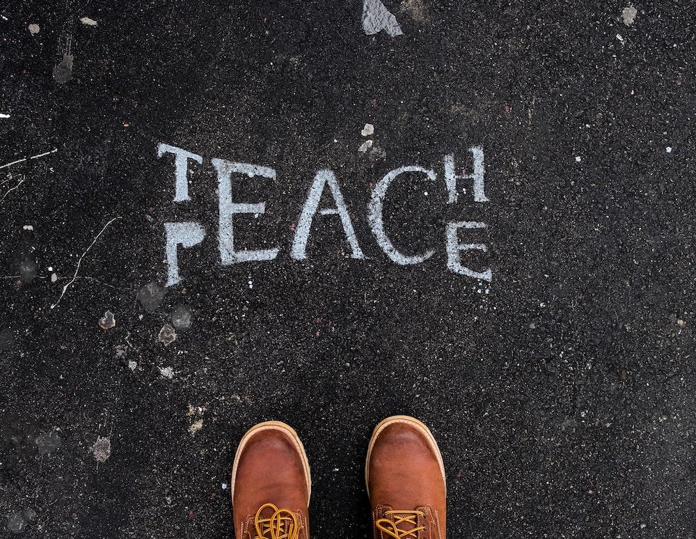 Teach and peace sign on surface