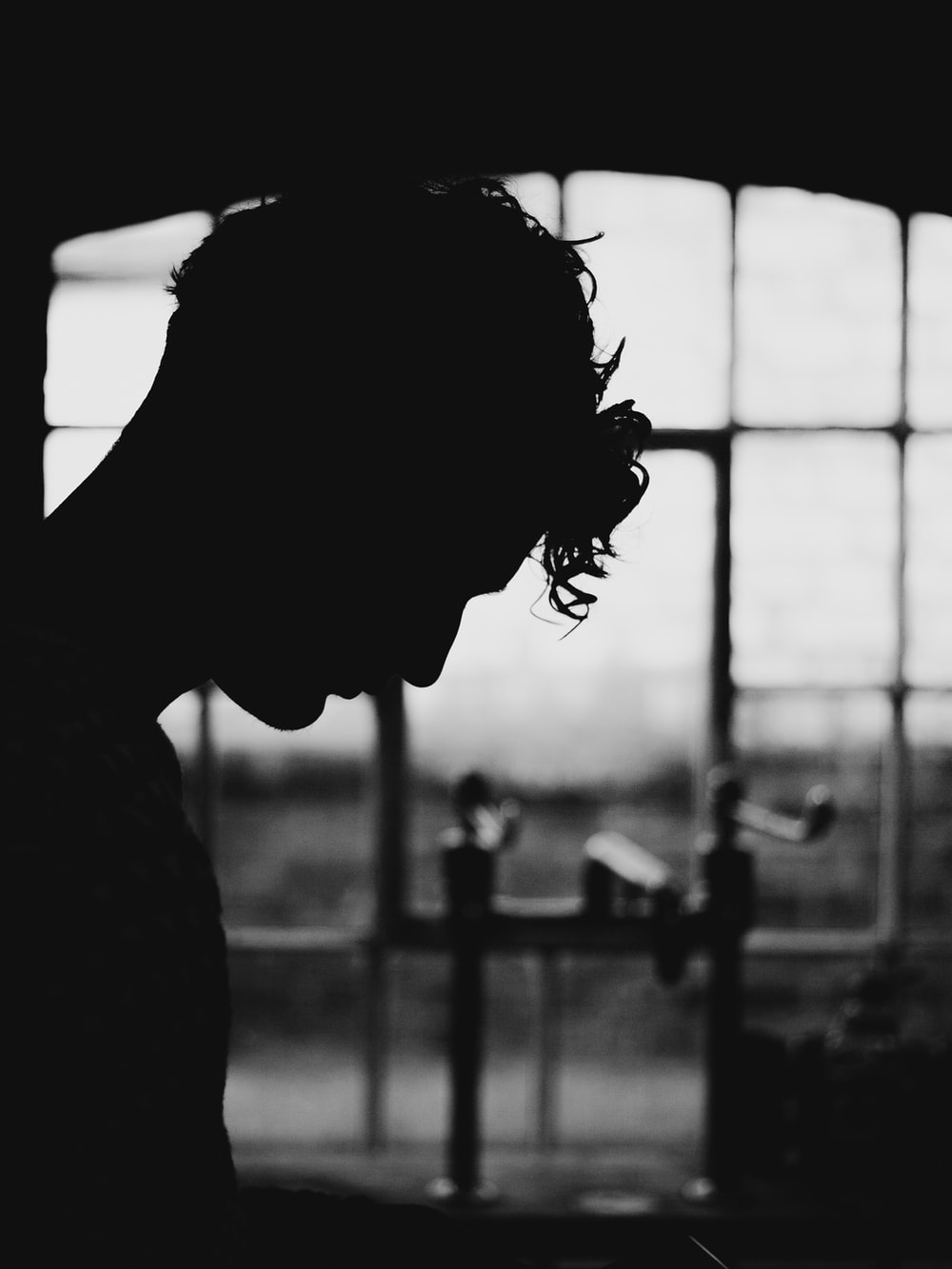 silhouette of person near window