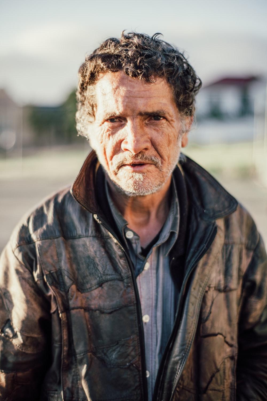 man wearing black zip-up jacket