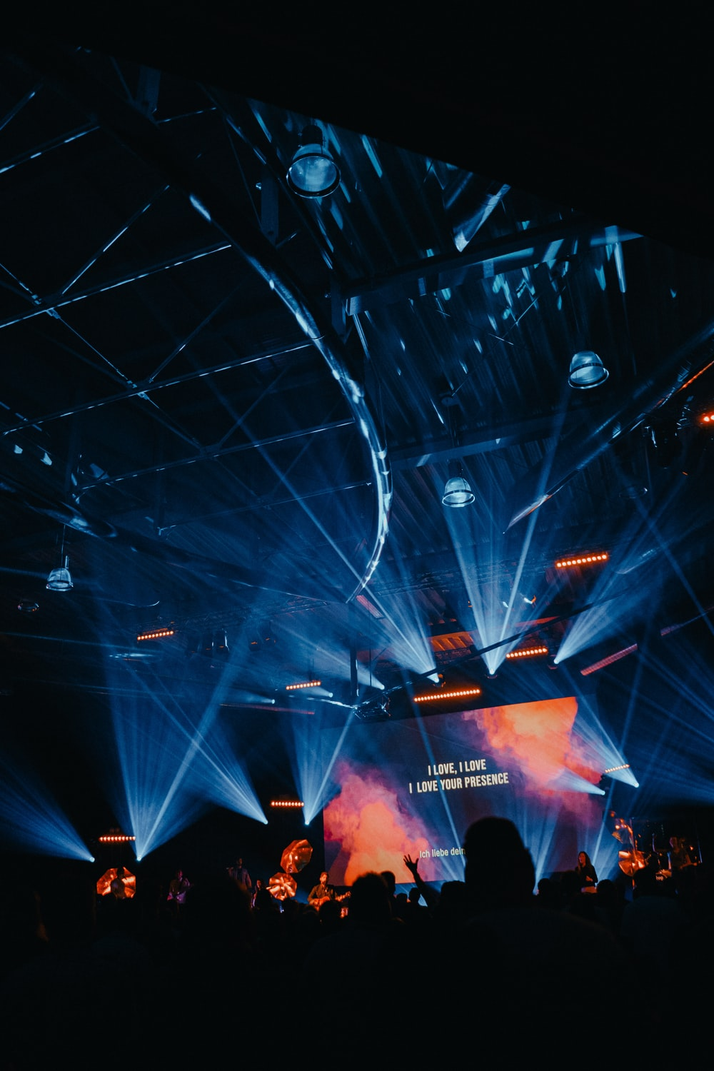 projector screen displaying text in stage with lights