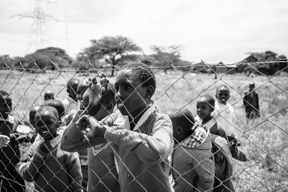 group of children inside fence