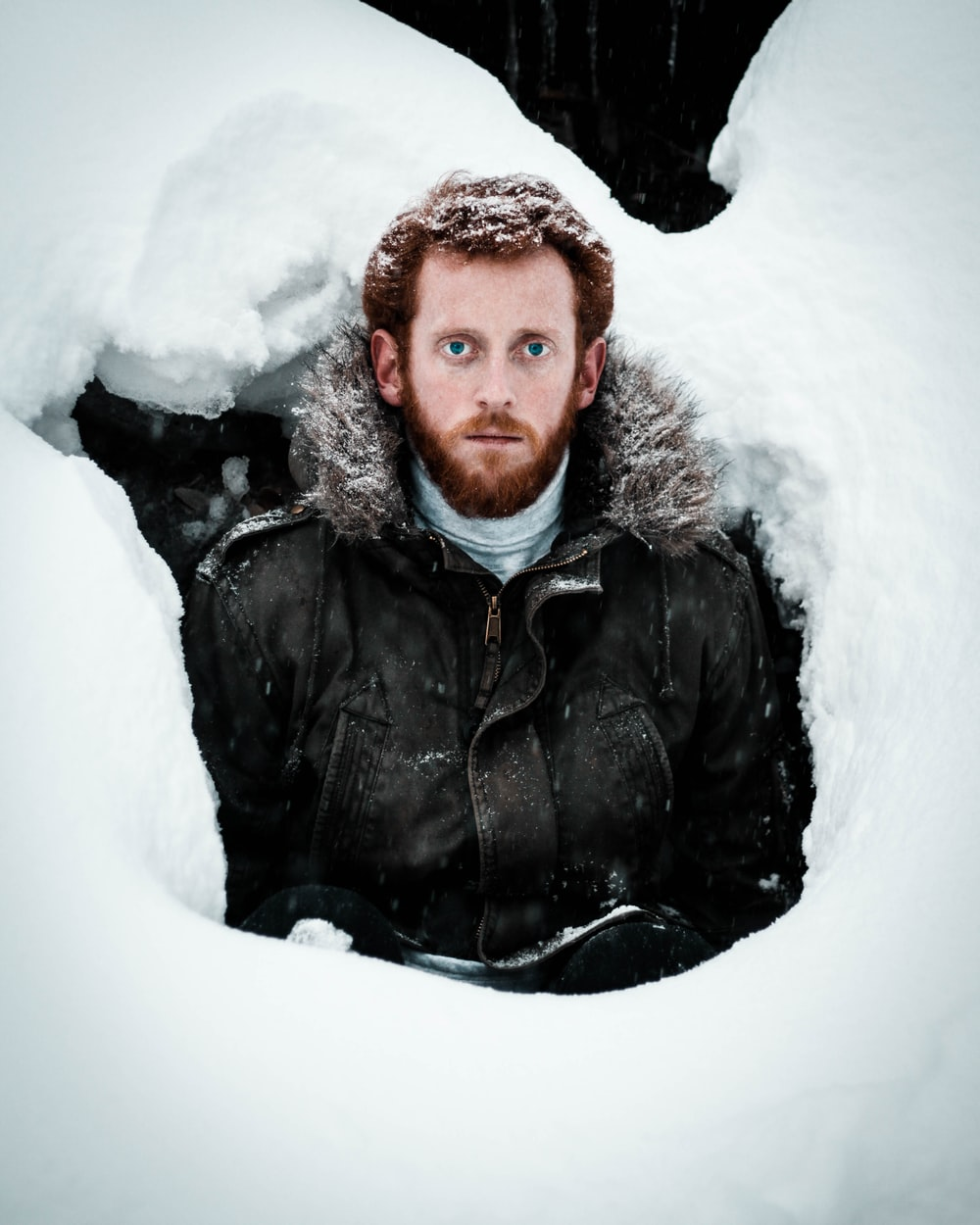 man in black leather jacket on snow