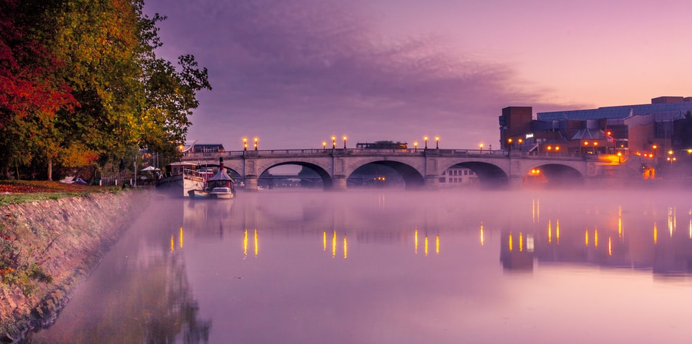 panoramic photography of bridge during golden hour