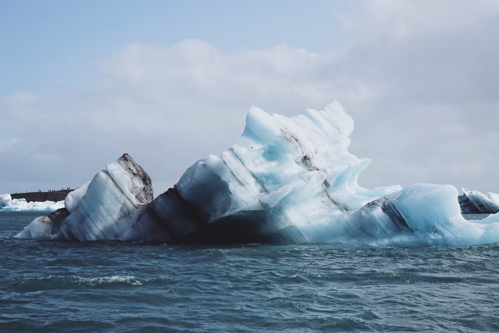 selective focus photography of iceberg