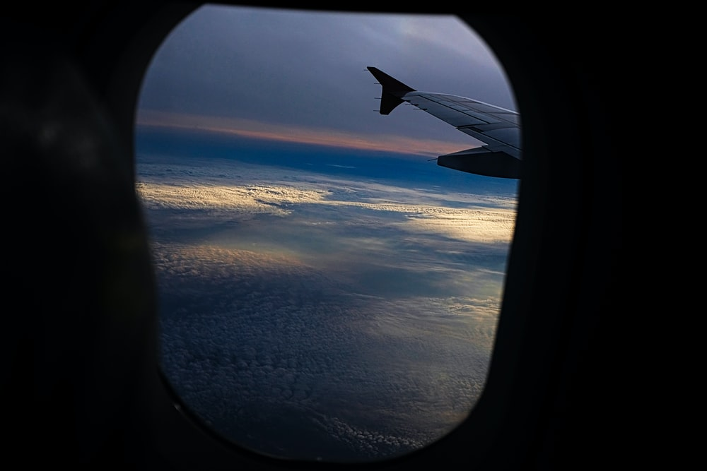plane window overlooking clouds formation