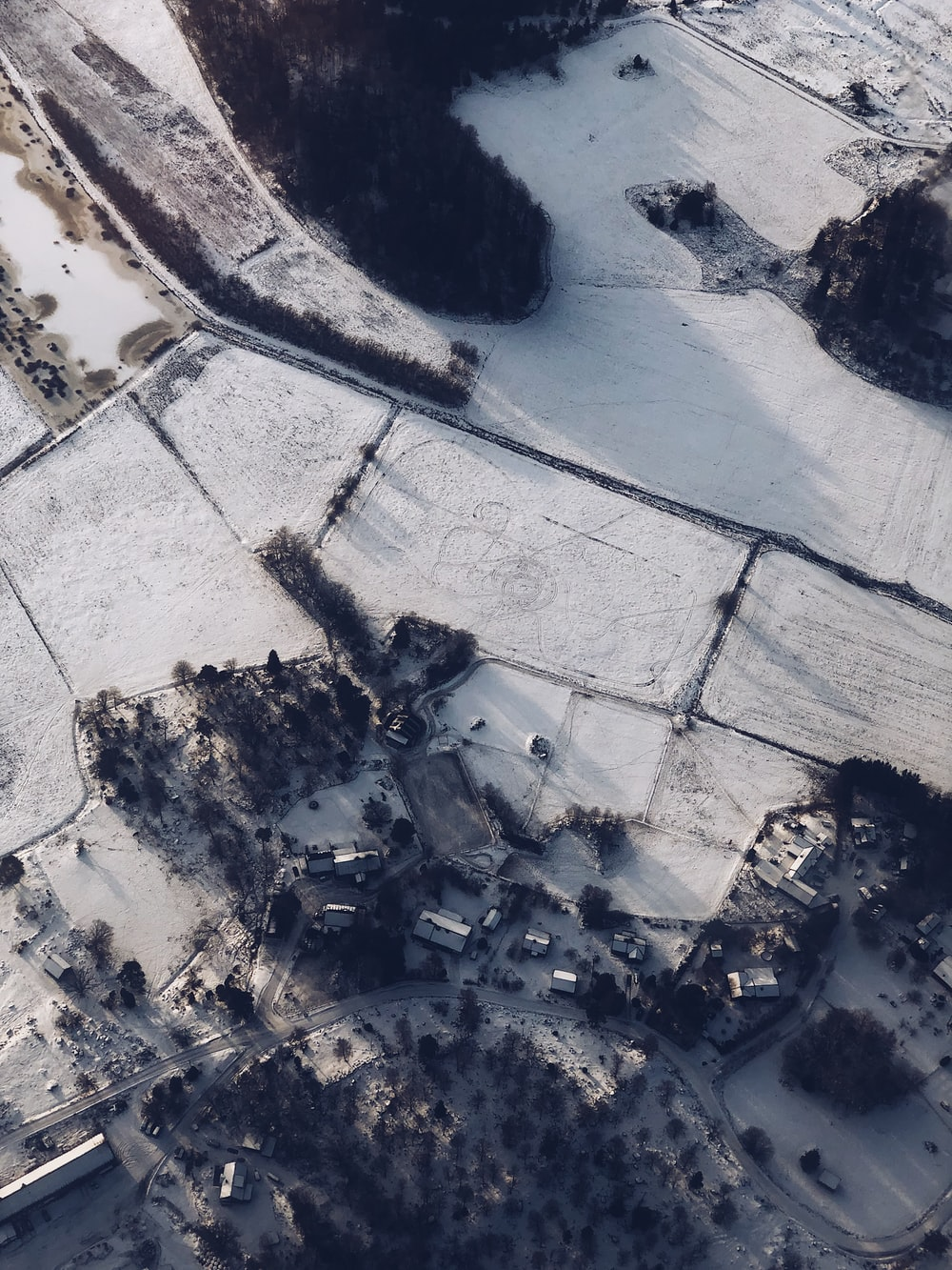 aerial photography of snow-covered field