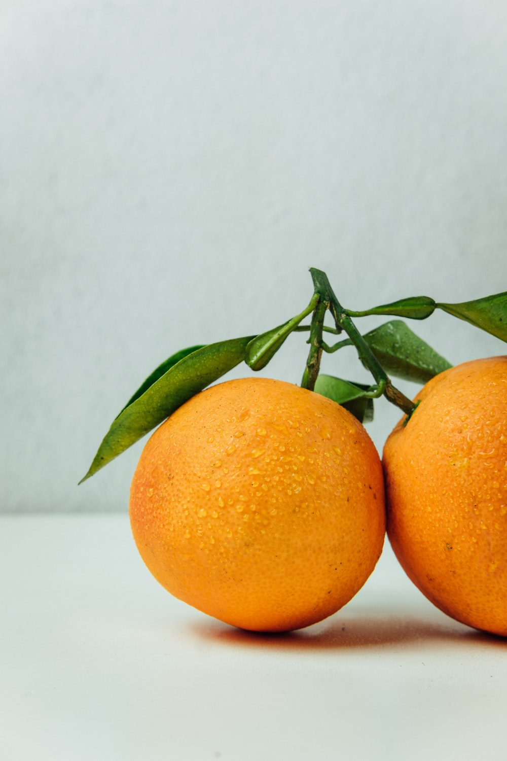 two orange fruits on table