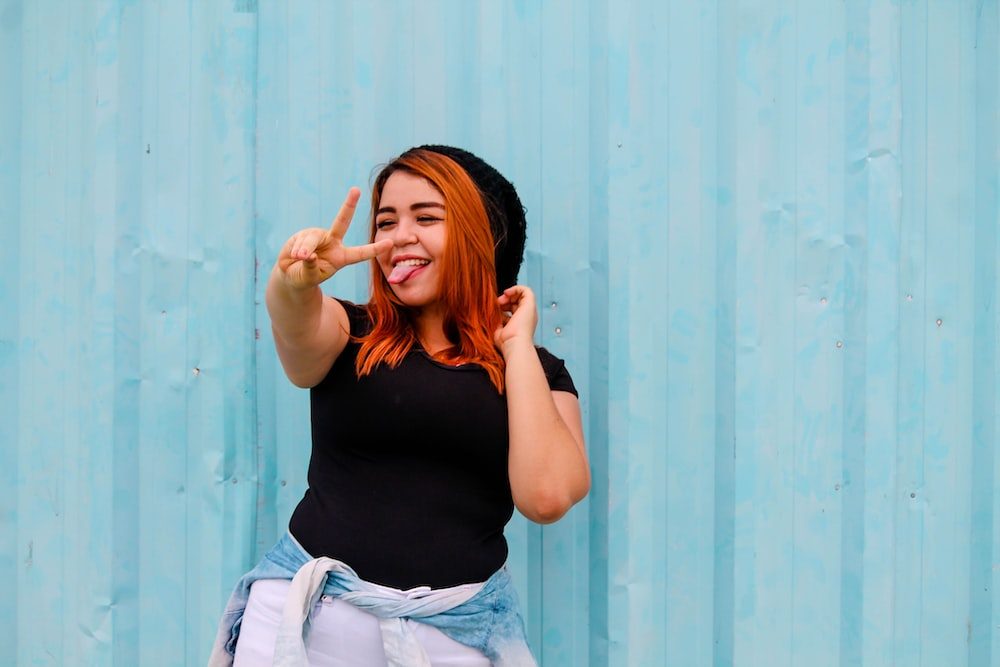 woman showing peace hand sign