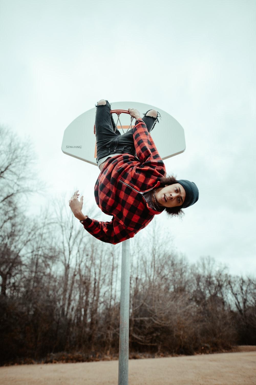 man hanged on basketball rim