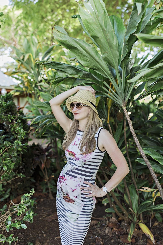 woman wearing dress standing near plant
