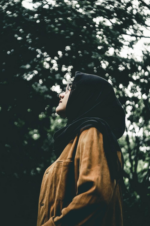 woman in black hijab headdress during daytime