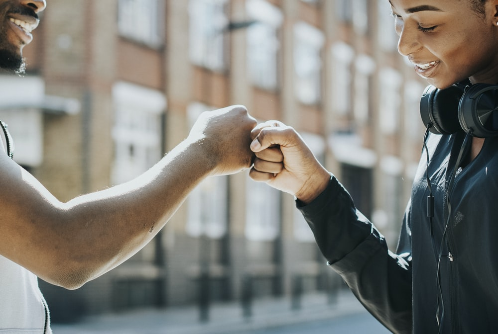 man and woman fist bump