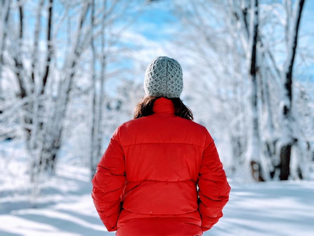 woman wearing red bubble jacket