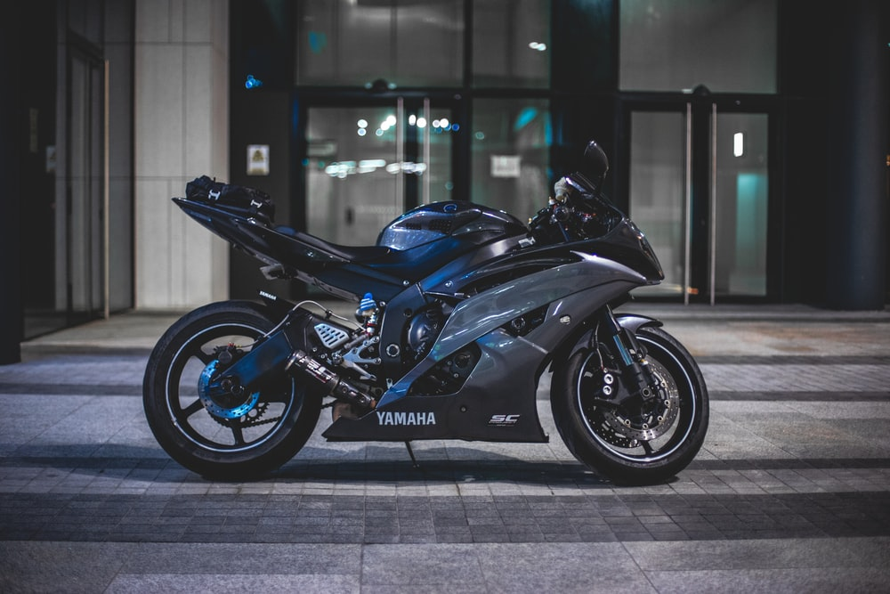 black Yamaha sports bike in front of building