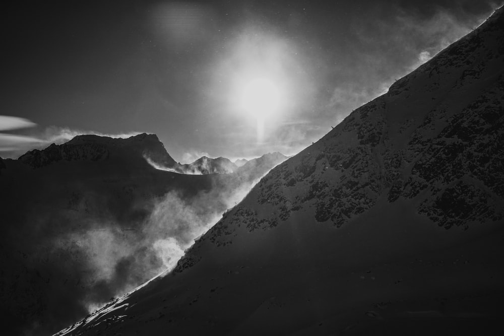 gray sun and icy mountain