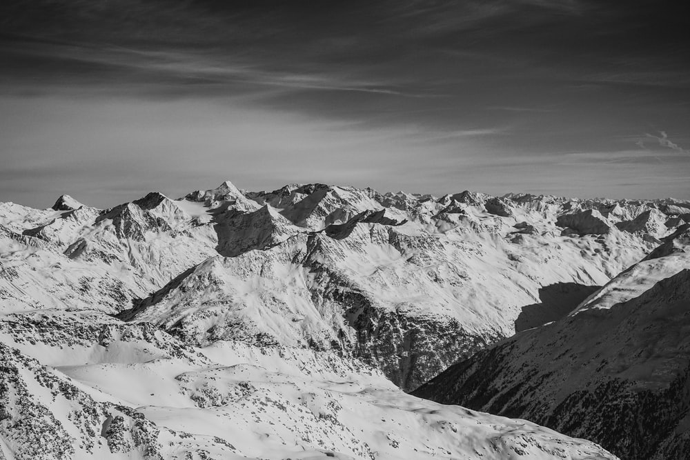 grayscale photo of mountain top