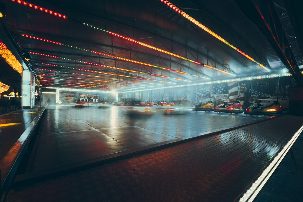 lighted parking lot with cars
