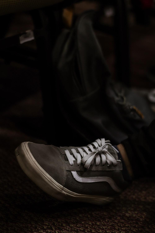 person wearing gray Puma sneaker