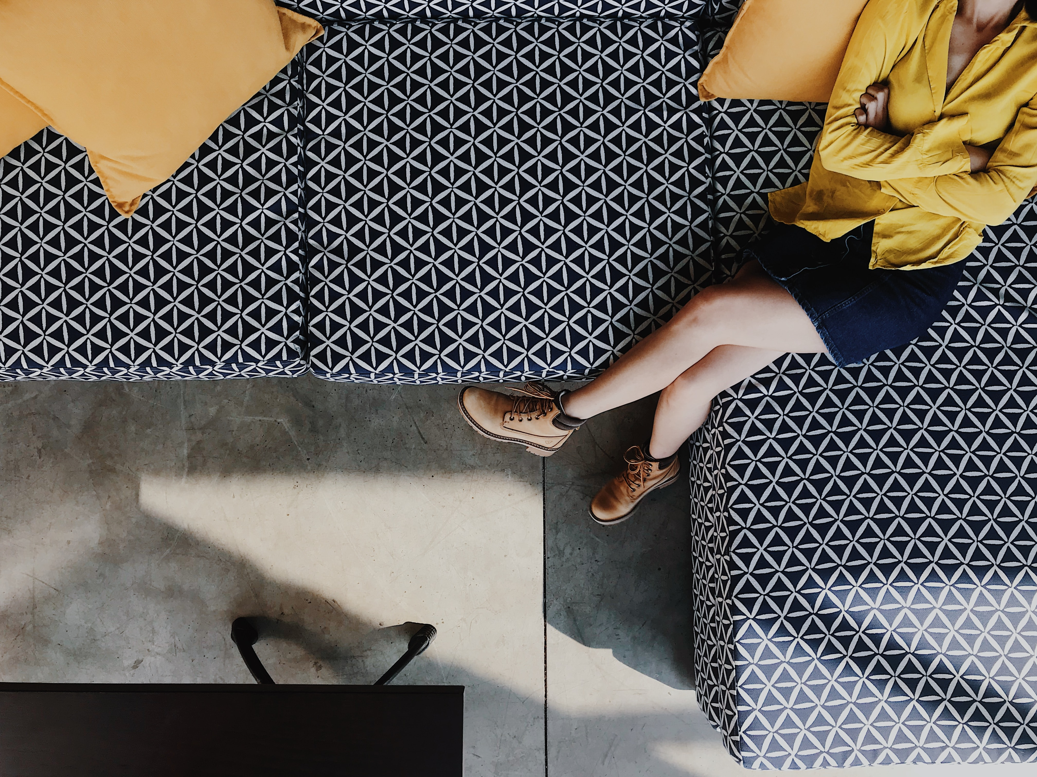 woman sitting on sofa in high angle photography