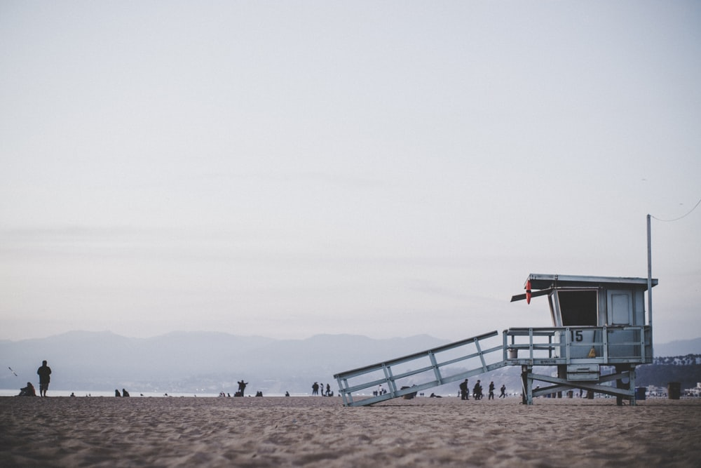 white guard post in the beach during daytime