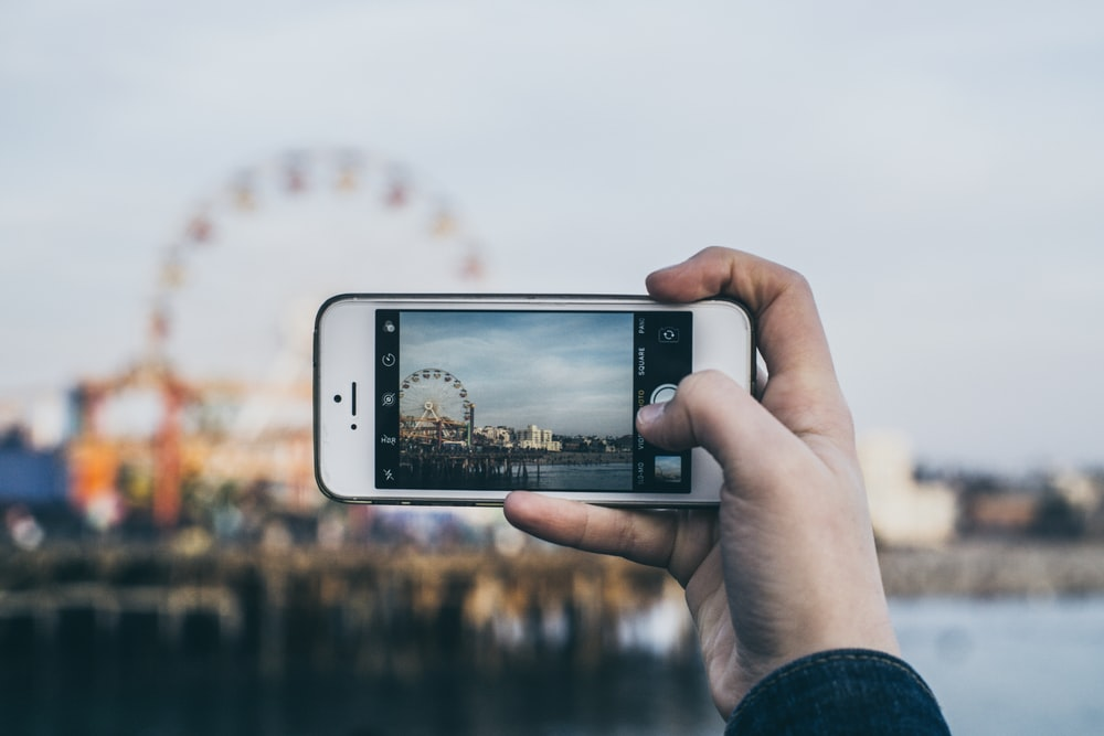 person taking picture Ferris Wheel