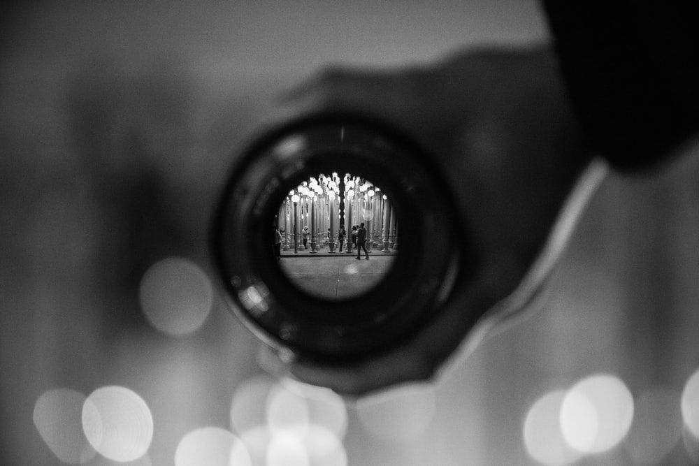 selective focus photography of lens