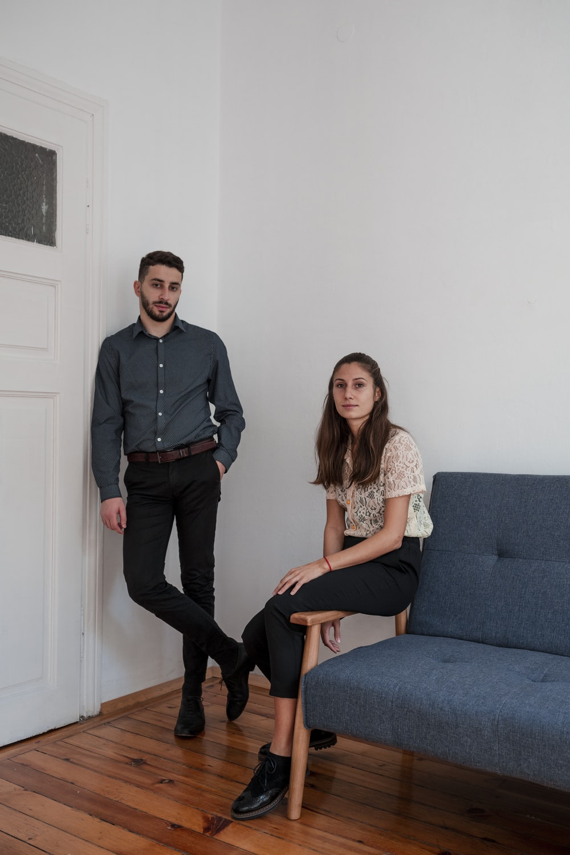 standing man beside sitting woman