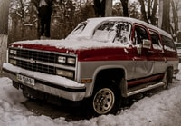 white and red single cab pickup truck