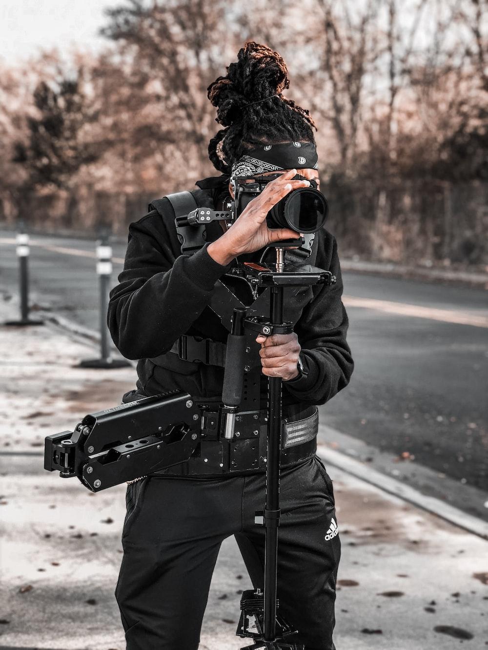person shooting camera