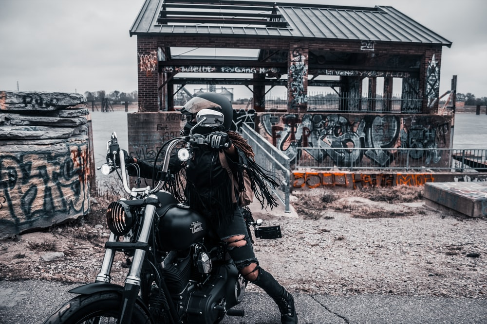 woman riding on cruiser motorcycle during daytime