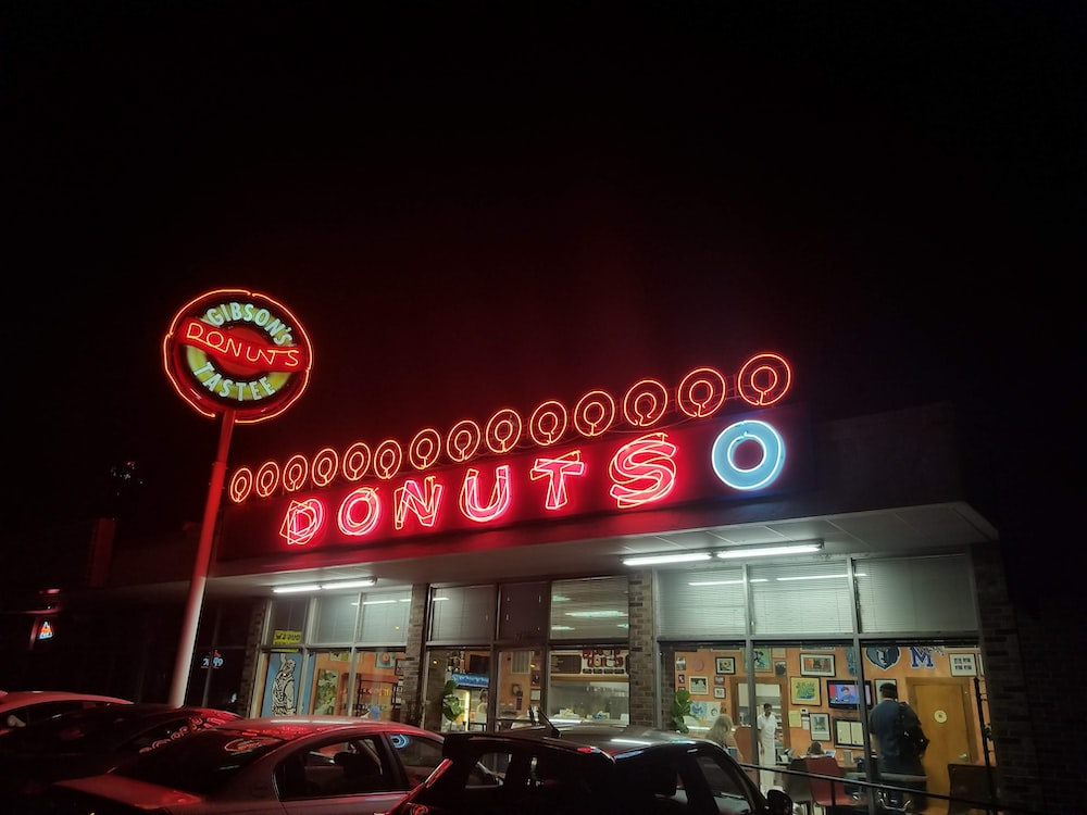 Donuts O store front during nighttime