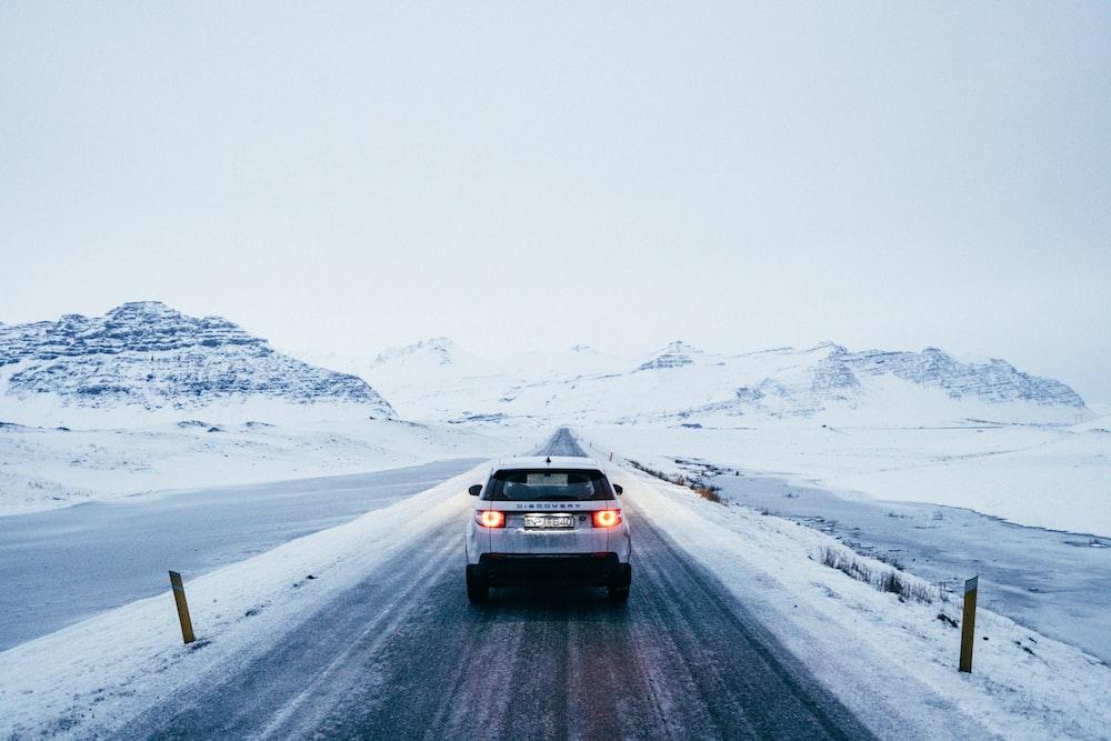 gray car near snow covered mountain